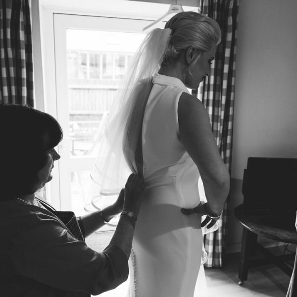 Bride getting ready for wedding at Sullington Manor Farm, West Sussex