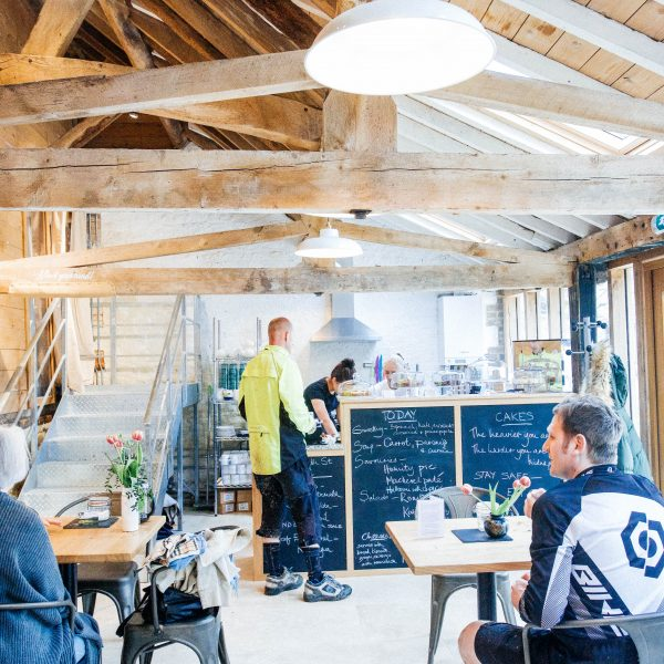 Cyclists enjoying a coffee in the Cafe at Old Workshop