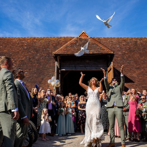 Releasing doves at wedding on Sullington Manor Farm, West Sussex